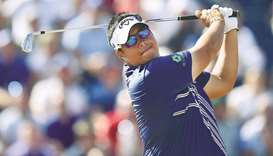 Thailand's Kiradech Aphibarnrat hits an iron shot from the third tee during the 147th Open golf cham
