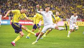 Sweden's Mikael Lustig shoots past Spain's Mikel Oyarzabal during the Euro 2020 Group F qualifying m