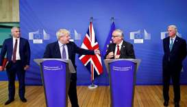 Britain's Prime Minister Boris Johnson, European Commission President Jean-Claude Juncker, European