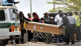 Pallbearers receive coffins of the victims of March 10 plane crash of Ethiopian Airlines' flight ET