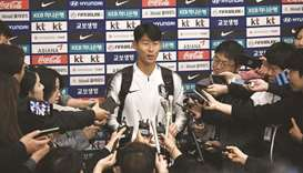 South Korean footballer Son Heung-min speaks to the media upon his arrival in Incheon yesterday. (AF