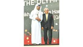 HE Sheikh Joaan bin Hamad al-Thani (left), President of the Qatar Olympic Committee, received the aw