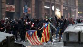 Catalan demonstrators protest during Catalonia's general strike in Barcelona