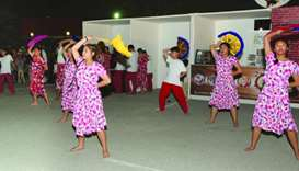 Students of Philippine International School Qatar performs a festival street dance for the event's o