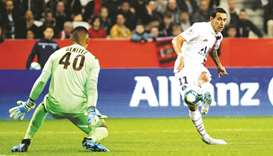 Paris Saint-Germain's Angel Di Maria (right) scores their first goal during the French Ligue 1 match
