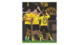Dortmund's Marco Reus (centre) celebrates his goal against Borussia Moenchengladbach in Dortmund, Ge