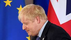 Britain's Prime Minister Boris Johnson leaves after attending a news conference at the European Unio