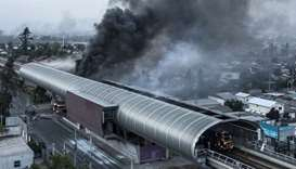 Aerial view of a burnt metro station after protests in Santiago