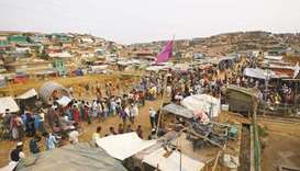 Rohingya refugees gather at a market inside a refugee camp in Cox's Bazar, Bangladesh. March 13, 201