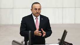Turkish Foreign Minister Mevlut Cavusoglu addresses lawmakers at the parliament in Ankara, Turkey, O