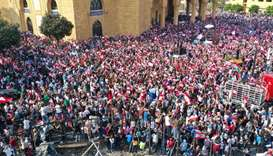 Lebanese protesters rallying in downtown Beirut on the fourth day of demonstrations against tax incr