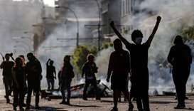 Demonstrators are seen at a barricade during protests in Valparaiso, Chile