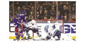 Canucks hang on to beat Rangers
