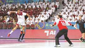 Qatar's Ahmed Madadi goes for a shot at goal against Saudi Arabia yesterday. Picture on right shows,