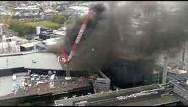 Smoke rises as a fire blazes at Sky City Convention Centre, which is under construction in Auckland,