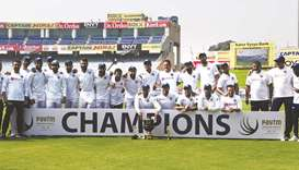 Indian team and support staff pose with the trophy after winning the third and final Test match agai