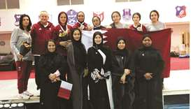 Qatar's fencing team with Lolwa al-Marri, President of Qatar Women's Sport Committee, and other memb