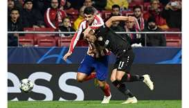 Atletico Madrid's Alvaro Morata (left) vies for the ball with Bayer Leverkusen's Nadiem Amiri during