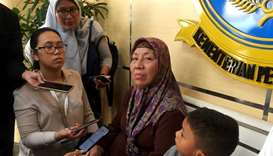 A family member of one of the flight attendants aboard the crashed Lion Air flight JT610 speaks to t