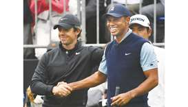 "Tiger Woods (right) shakes hands with Rory McIlroy during the ""Japan Skins"" pre-match at the Narashi"