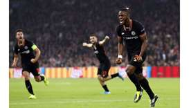 Chelsea's Belgian striker Michy Batshuayi (R)celebrates after scoring against Ajax Amsterdam at the