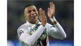 Paris Saint-Germain's French forward Kylian Mbappe celebrates at the end of the match against Brugge