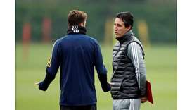 Arsenal manager Unai Emery and Mesut Ozil during training at St. Albans, England.