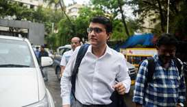 Former cricketer Sourav Ganguly (C) arrives for an electoral meeting at the Board of Control for Cri