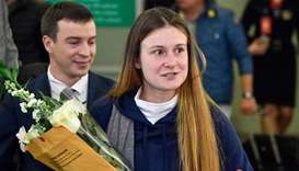 Russian woman convicted by US of being agent returns home
