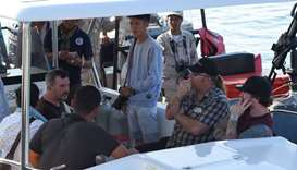 Relatives of missing British woman Amelia Bambridge leave on a boat to continue their search, in Koh
