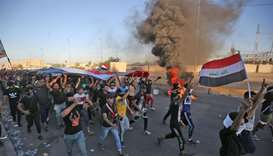 Iraqi protesters take part in a demonstration against state corruption, failing public services, and