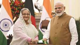 India's Prime Minister Narendra Modi and Bangladesh Prime Minister Sheikh Hasina, at the Hyderabad H