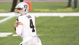 Derek Carr of the Las Vegas Raiders looks to pass in the second half against the New England Patriot