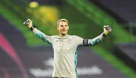 This file photo taken on August 19, 2020, shows Bayern Munich's German goalkeeper Manuel Neuer celeb