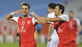 Persepolis' Isa al-Kasir (left) celebrates his goal during the AFC Champions League quarter-finals a