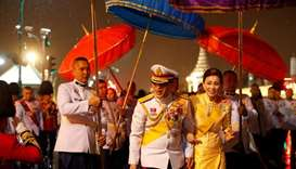 Thailand's King Maha Vajiralongkorn and Queen Suthida greet royalist supporters who gathered outside