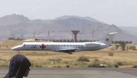 An ICRC plane carrying prisoners is seen on the tarmac of an airport in Yemen's Houthi rebel-held ca