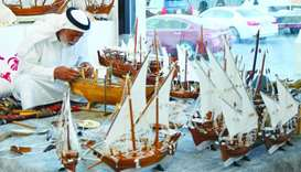 A local artisan demonstrates how to make miniature dhows. PICTURE: Ram Chand