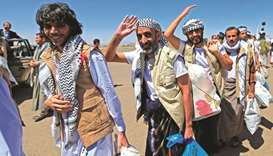 Freed Yemeni prisoners arrive in the rebel-held capital Sanaa, yesterday, as the country began swapp