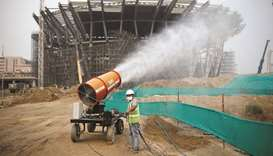 A worker operates an anti-smog gun at a construction site in New Delhi.