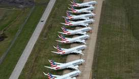 A line of American Airlines Boeing 737 MAX passenger planes are parked on the tarmac at Tulsa Intern