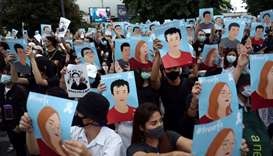 Pro-democracy demonstrators hold posters of protest leaders who have been arrested during an anti-go