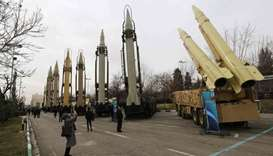 Iranians visiting a weaponry and military equipment exhibition in the capital Tehran, organised on t