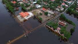 An aerial picture taken on October 15, 2020 shows houses submerged in flood waters caused by heavy r