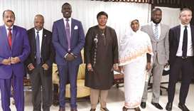Prosecutor of the International Criminal Court, Fatou Bensouda (centre), poses with Sudanese officia