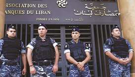 Lebanese police stand outside the entrance to the Association of Banks in downtown Beirut, Lebanon (