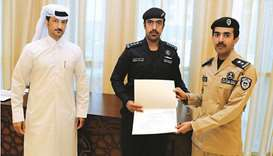 MoTC assistant undersecretary of Maritime Transport Affairs Dr Saleh bin Fetais al-Marri handing ove