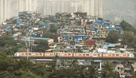 Metro train in slum