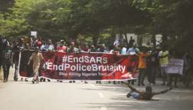 Protesters carry a banner during a demonstration to press for the scrapping of Special Anti-Robbery