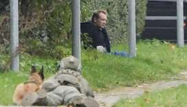Peter Madsen is seen surrounded by police in Albertslund, Denmark. Ritzau Scanpix/Nils Meilvang via